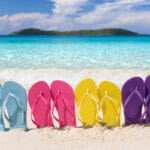 Learn How to Choose a Summer Shoe - Flip Flops on a Beach